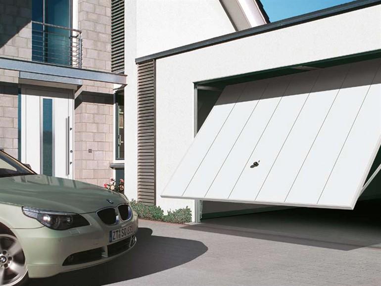 Portes de garage basculantes maison du store et de la for Porte de garage electrique